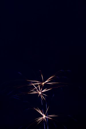 Three red bursts with blue sparks flying out Stock Photo - 1358280