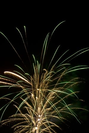 Chaotic series of firework bursts white and green Stock Photo - 1358324