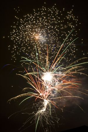 newyears: Night sky erupts into  firey chaos with flashes, sparks, and trails Stock Photo