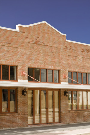 brick: Brick facade storefront with awning in the afternoon