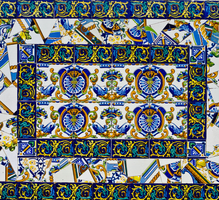 Colorful spanish broken painted tiles mosicac with interesting designs