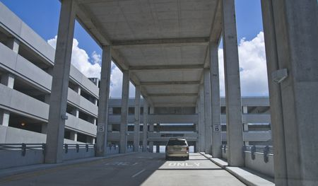Driving up into a parking garage structure Stock Photo