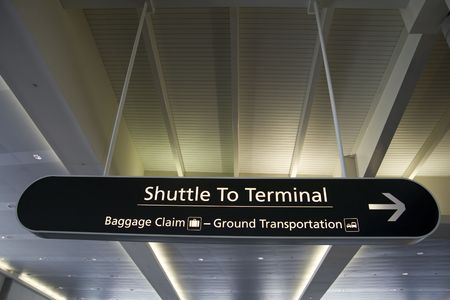 Sign in airport directing the way to the main terminal shuttle