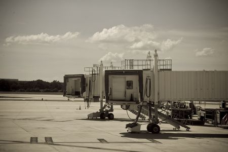 Grainy sepia toned view of a  partially exrtended jetway Stock Photo