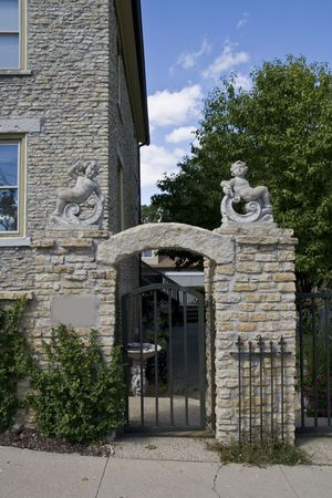 Stone archway with gate and cherubs