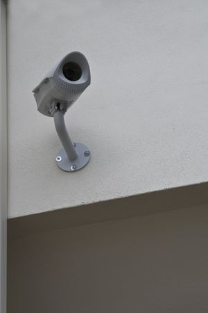 Security camera mounted on exterior wall of offices photo