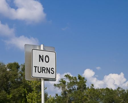 No turns sign with sky as dominant background, selective focus on sign