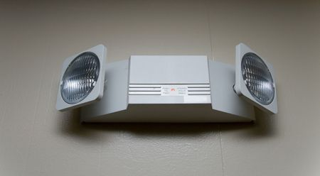 Dual head emergency light mounted on wall Stock Photo