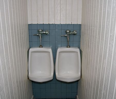 mensroom: Two urinals in public restroom very closely situated