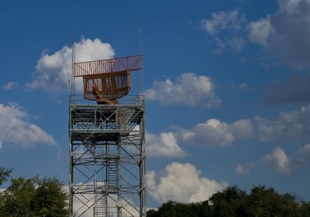 air traffic: Air traffic control radar tower against blue sky with clouds Stock Photo