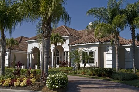 pavers: Nice house with paver driveway and palm trees