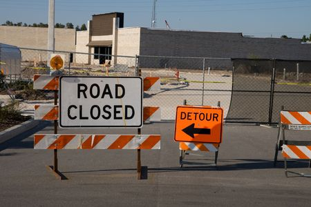 detour: Road closed and detour signs on road barriers Stock Photo