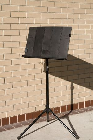 Music Easel near brick wall in the afternoon
