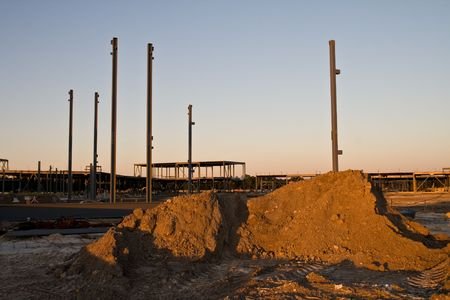 steelwork: Construction site in the dusky golden  glow of the late afternoon Stock Photo