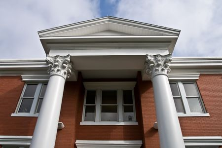 pediment: Second story of the front of a neo classical building showing columns and pediment