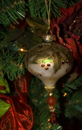 Painted glass christmas ornament with holly leaves and berries