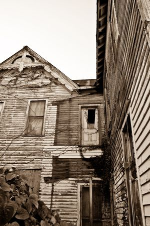 dilapidated wall: Sepia toned dilipadated victorian house showing door to nowhere