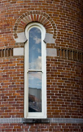 Window in a curved brick wall Imagens