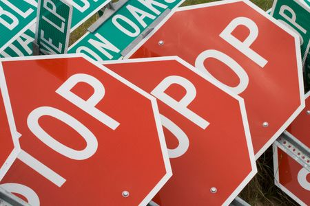 Stop signs piled up on a construction site Stock Photo - 2512986