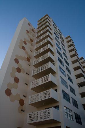 Modern condos against a deep blue sky Stock Photo