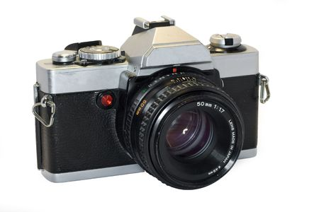 Heavily used, slightly grimy and beatup SLR camera with white background Stock Photo