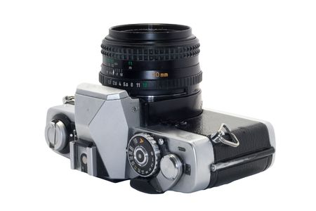 heavily: Heavily used, slightly grimy and beatup SLR camera with white background Stock Photo