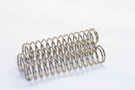 Steel compression springs against a white background Stock Photo
