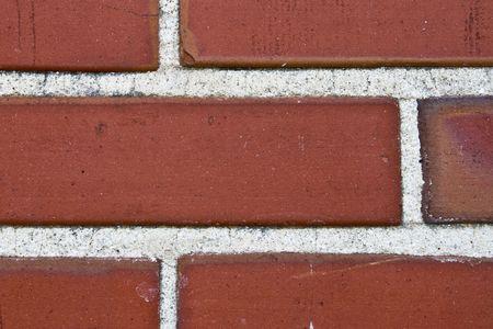 Close up of bricks and mortar wall Фото со стока