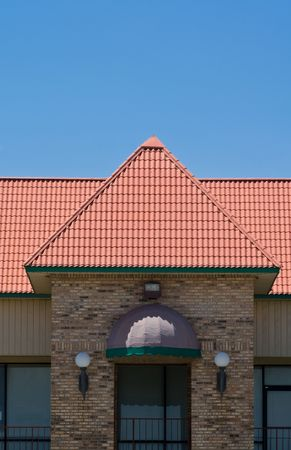 awnings: Parapet on an office building upstairs with railing Stock Photo