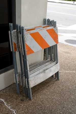 Barricades leaning against a wall on the corner of a building