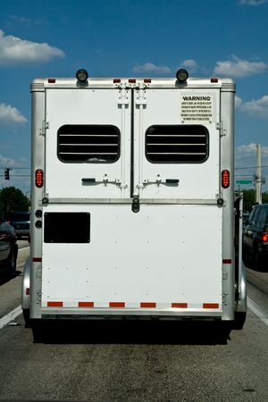 Horse trailer viewed from behind on the road Stock Photo