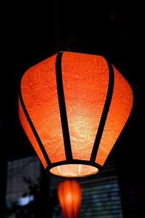 Orange Oriental lamp with textured cloth photo