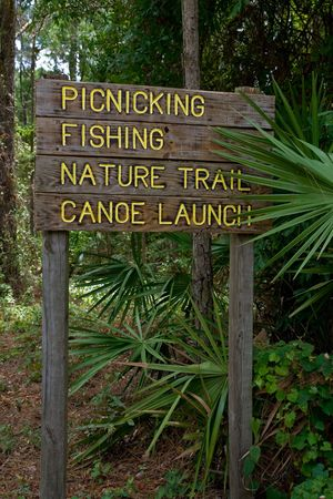 picknick: Sign in nature park listing various activities Stock Photo