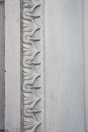 Closeup view of an old crackled and chipped moulding on a wall