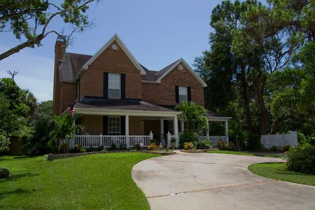 Fancy brick house with nice landscaping