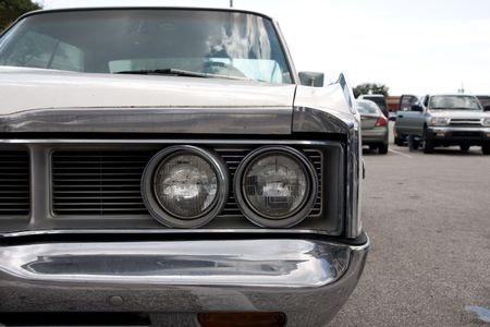 frontend: Close up of  front end of a car with round headlights Stock Photo