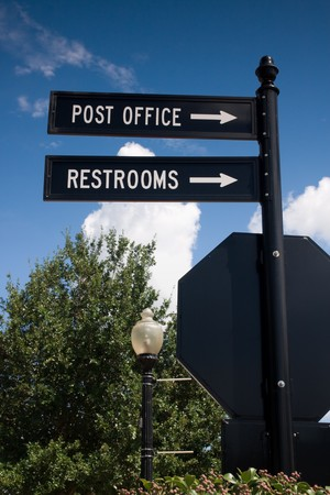 Street signs pointing the way to the post office and restrooms Stock Photo - 4032042