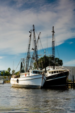 Fishing boats moored side by side in a channel