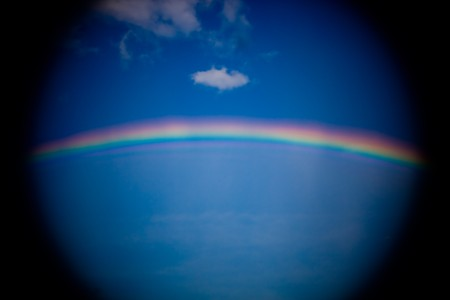 vignetted: Tunnel vision vignetted rainbow with some clouds Stock Photo