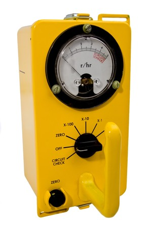 Yellow classic geiger counter isolated on white Imagens