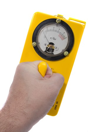 Yellow classic geiger counter in hand isolated on white Stock Photo