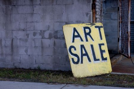 Beat Up Art Sale Sign Board Leaning Against Block Wall Near open Gate with copyspace to the left