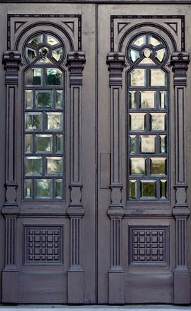 Ornate antique wooden doors with windows