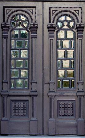 moorish: Ornate antique wooden doors with windows