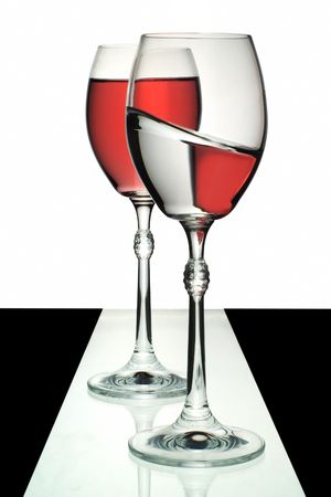 inclined: Two wine glasses, one with wine, one with water