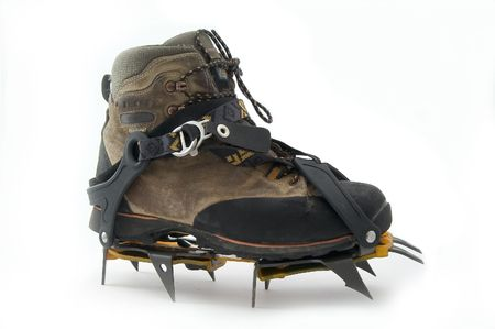 crampons: Boot with crampons. Stock Photo