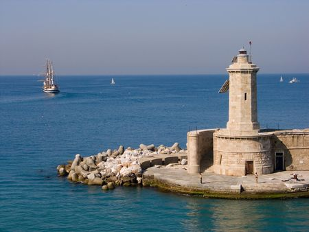 frence: Lighthouse and the historic sailboat Stock Photo