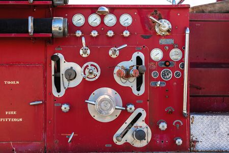 Detailed view of the hoses, dials and gauges on a classic fire engine