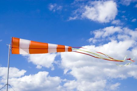 Wind sock in front of blue sky photo