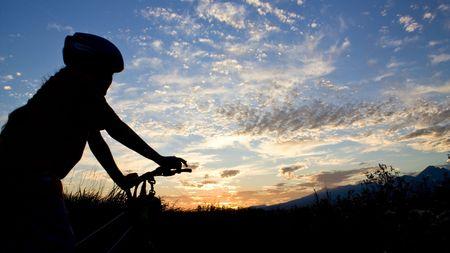 Biker girl silhouette in sunset photo